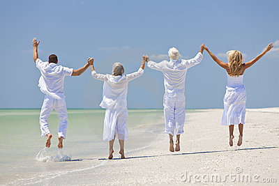 People Seniors Family Generations Jumping on Beach