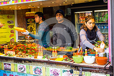 People serving food at Camden Food