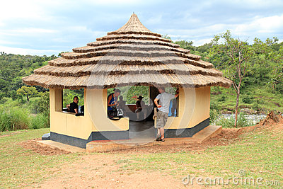 People in a Shaded Safari Shelter