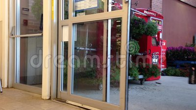 People With Shopping Cart Walking Through The Doors Of Superstore Stock Video - Video of sliding automatic 47464383 & People With Shopping Cart Walking Through The Doors Of Superstore ...