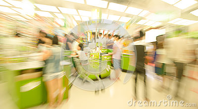 People shopping in the supermarket, the fuzzy movement