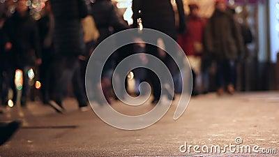People on sidewalk. Crowded crosswalk. City life. Evening. Legs. Asphalt. People walking on sidewalk. Crowded crosswalk. City life. Evening. Legs. Asphalt stock video footage