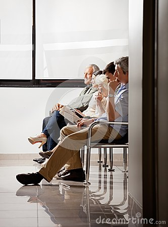 Free People Sitting In Waiting Area Royalty Free Stock Photography - 36360507