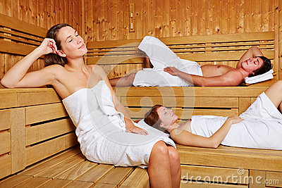 People sitting relaxed in sauna