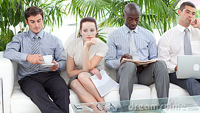 People sitting on a sofa waiting for an interview