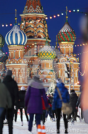 People skate on Red Square near to Saint Basil Cathedral