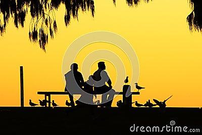 People sketch in dusk