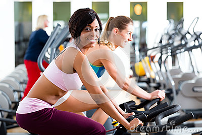 People Spinning in the gym on bicycles