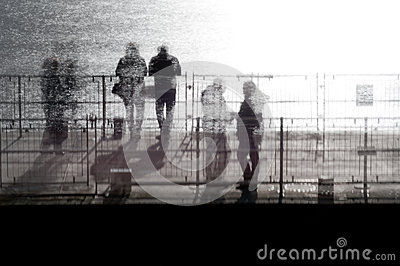 People standing on a pier