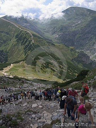 People are standing in a queue on  peak Giewont Editorial Stock Image