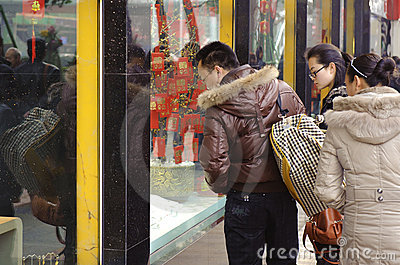 People  stop to look in the window of a gold shop Editorial Stock Photo