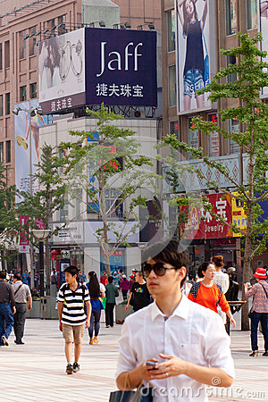People on streets of Beijing Editorial Stock Image