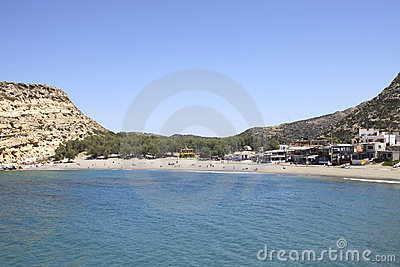People sunbathing on the beach of Matala in Crete Editorial Stock Image
