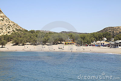 People sunbathing on the beach of Matala in Crete Editorial Photo
