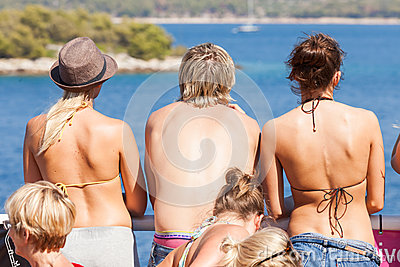 People are sunbathing on the deck Editorial Stock Photo