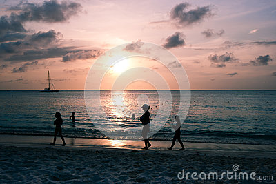 People at sunset on Palm Beach, Aruba Editorial Photo