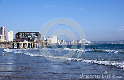 People Surfing and Swimming in Sea in Durban Editorial Image