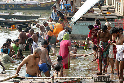 People take a dip in holy river Ganges Editorial Stock Image