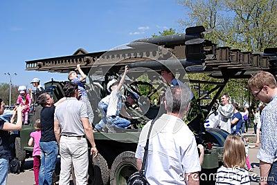 People take photos of an old gun machine Editorial Stock Image
