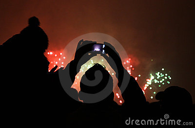People take a pictures of fireworks