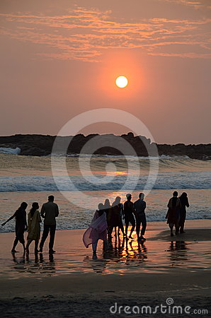 Free People Taking Sunset Stroll On Beach Royalty Free Stock Images - 24444069