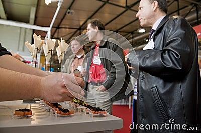 People tasting food Editorial Stock Photo