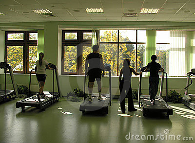 People with teacher in health club