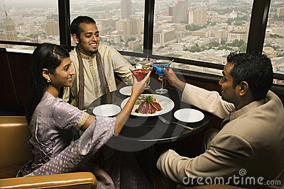 People Toasting in Restaurant