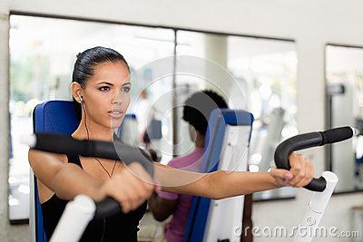 People training and working out in fitness club
