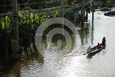 People travel by boat on the road during flood Editorial Photo