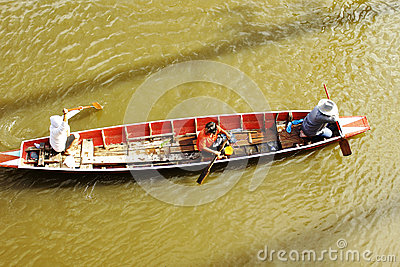 People travel by boat on the road during flood Editorial Stock Image