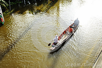 People travel by boat on the road during flood Editorial Photography