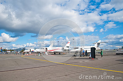 People Travelling by Commercial Airplane Editorial Stock Photo
