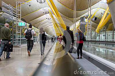 People in a travolator at Barajas airport, Madrid. Editorial Stock Image