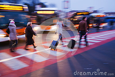 People with trollies at a bus station