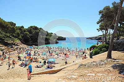 People on tropical beach, Cala dOr, Mallorca Editorial Image
