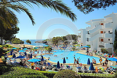 People at tropical resort, Cala dOr, Mallorca Editorial Stock Image
