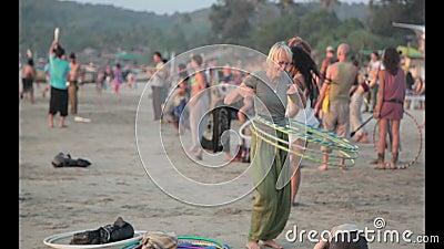 People twist hoop on beach. Goa-India, january 2015. Beach Arambol stock footage