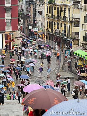 Free People Under Umbrellas. Rainy Day. Macau. Stock Images - 22937304