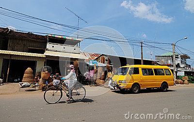 People and vehicles on street in Kep, Cambodia Editorial Stock Photo