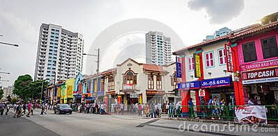 People and vehicles on street in Little India, Singapore Editorial Stock Photo