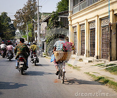 People and vehicles on street in Mandalay, Myanmar Editorial Stock Photo
