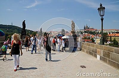 People visit the Charles Bridge in Prague. Editorial Stock Image
