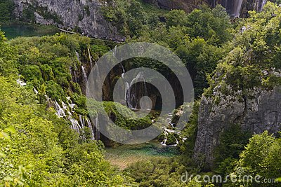 People visit the plitvice lakes by foot