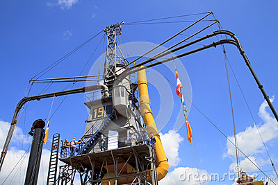 People visiting gigantic steam crane in Dordrecht. Editorial Stock Image