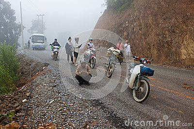 People wait for clearing a road after landslide Editorial Image