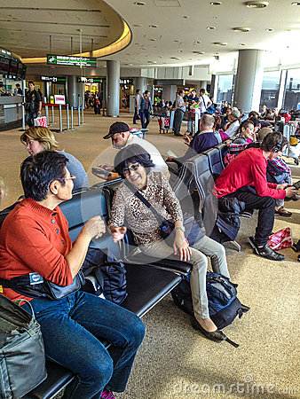 People waiting at the airport Editorial Image