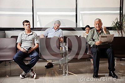 People Waiting In Hospital Lobby