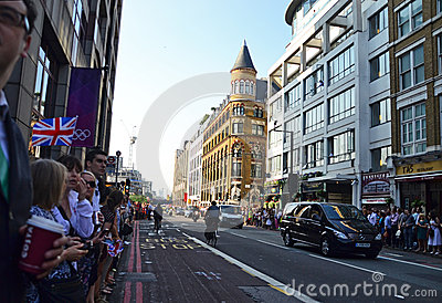 People waiting for the Olympic torch to arrive Editorial Image