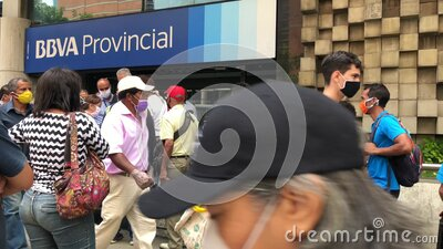 People waiting to enter Provincial Bank BBVA wearing protective mask stock video footage